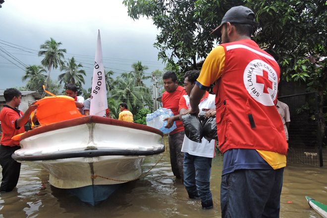 Red, Cross, volunteers, boat, relief, distribution